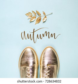 Autumn golden  leaves and stylish shoes on  blue background. Flat lay, top view