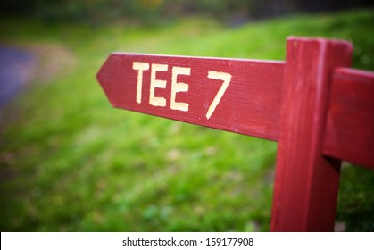 Autumn golf course with tee sign