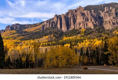 Autumn at High Mesa Pinnacles - Autumn evening view of a rugged ridge line, known as High Mesa Pinnacles, at side of Owl Creek Pass Road, near Cimarron-Ridgway, Colorado, USA.
