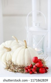 Autumn home decorations in scandinavian style. White baby boo pumpkin and hay wreath with rose hip and hawthorn berries. Step by step, tutorial.