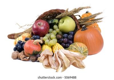 A autumn horn of plenty. Cornucopia full of fruits and vegetables.