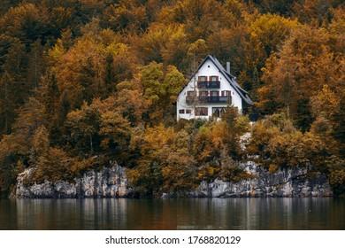 autumn house on the cliff - Shutterstock ID 1768820129