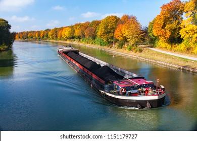 Autumn Inland Waterway with Inland Vessel