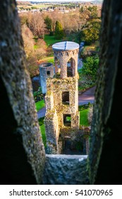 Autumn in Ireland. Aerial view of Blarney Castle tower in Ireland. Forest and fields at the background