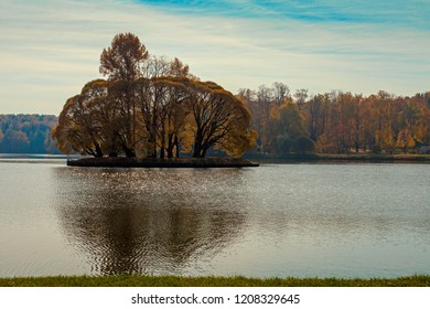 Autumn island on the pond in the park