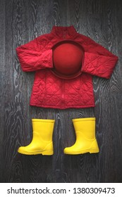 Autumn jacket, rubber boots and hat, a playful image of children