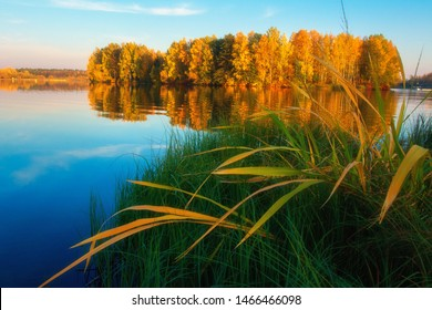 Autumn lake. Autumn nature landscape. Fall. Scenic autumn. Picturesque view on  riverside. Beautiful river in clear autumn evening