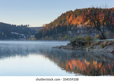 Autumn lake Palcmanska Masa at sunrise with fog and color reflection, Dedinky, Narodny park Slovensky Raj (National park Slovak paradise), Slovakia, Eastern Europe - Shutterstock ID 334559108