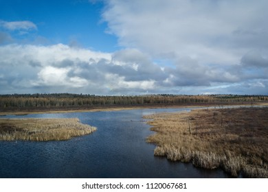 Autumn lake with white clouds