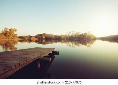 Autumn lake with wooden dock