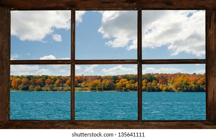 Autumn lakefront view on Manitoulin Island, Canada, seen through the cottage window.   Part of a series.