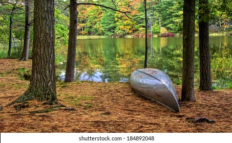 Autumn Lakeshore. Aluminum canoe along the forested lakeshore. Ludington State Park. Ludington, Michigan.