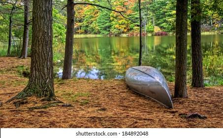 Autumn Lakeshore. Aluminum canoe along the forested lakeshore. Ludington State Park. Ludington, Michigan.