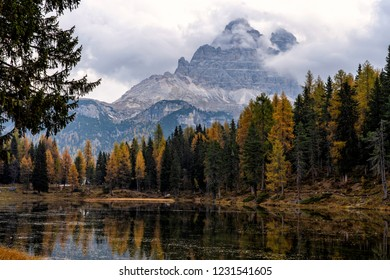 Autumn landscape of Antorno lake with mountain peak of Tre Cime di Lavaredo in background in Eastern Dolomites, Italy, Europe. Beautiful nature scenery and scenic travel destination in autumn colors.