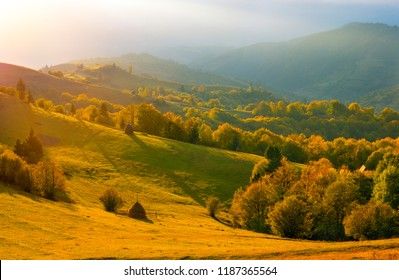 Autumn landscape. Autumnal mountains. Colorful hills and valleys in the evening. Fall nature.