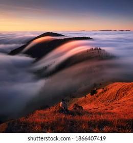 Autumn landscape, beautiful sunrise above the heavy clouds, Mountain sea
