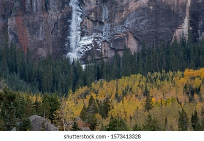 Autumn landscape of Bridal Veil Falls with aspens and conifers, San Juan Mountains, Telluride, Colorado, USA