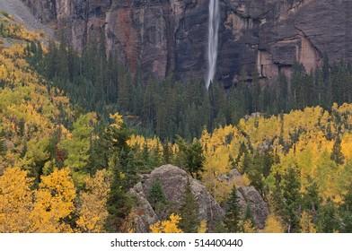 Autumn landscape of Bridal Veil Falls with aspens and conifers, Telluride, Colorado, USA