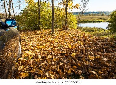 Autumn Landscape with a car