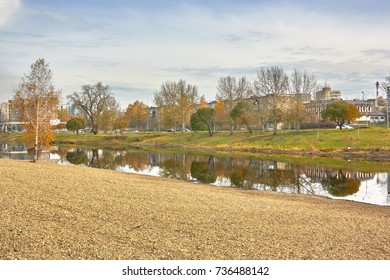 Autumn landscape in the city park by the river