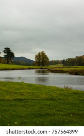 Autumn landscape with a cloudy skay and a small river in Derbyshire, England