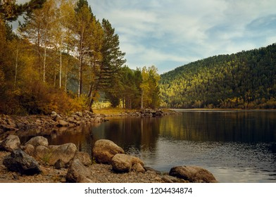 Autumn landscape with forest, mountains and river