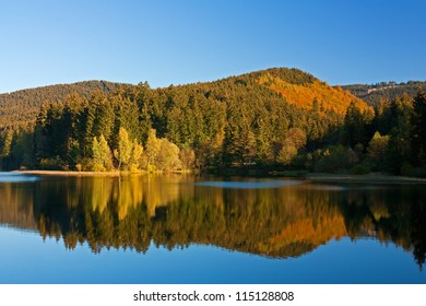 Autumn landscape in the Harz Mountains, Lower Saxony, Germany. Barrier lake of the Soese river.