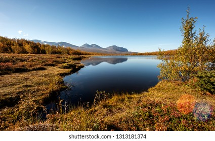 Autumn landscape with a lake. Northern Sweden