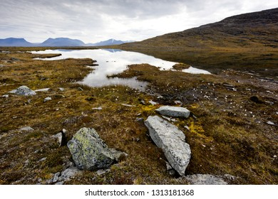 Autumn landscape with a lake and stones in mountains. Abisko National Park, Northern Sweden
