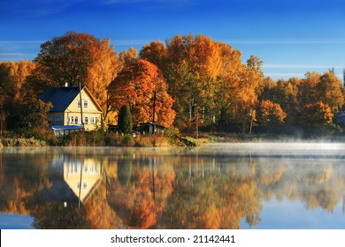 Autumn Landscape with lake and yellowed trees