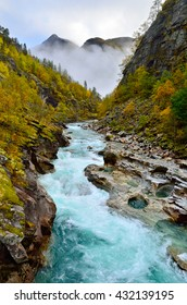 Autumn landscape with mountain river. Norway.