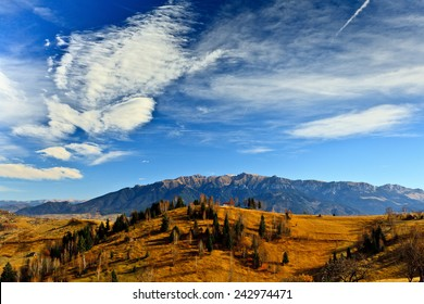 Autumn landscape with mountains and blue sky