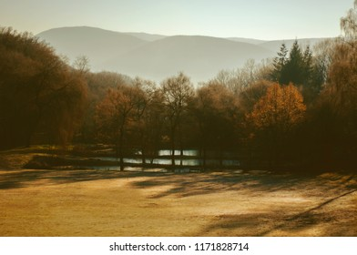 Autumn landscape. Mountains, forest, lakes. Warm day.