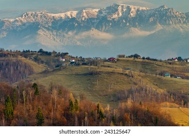 Autumn landscape with mountains and rusty hills