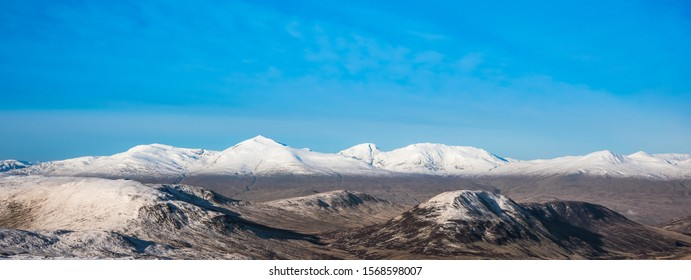 Autumn landscape in the mountains of Scotland with the first snow - Shee of Ardtalnaig, Creagan na Beinne, Meall nan Eanchainn