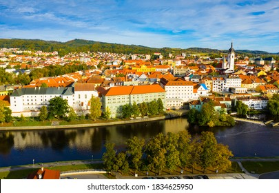 Autumn landscape with Old Town of Czech city of Pisek on banks of Otava river on sunny day.. - Shutterstock ID 1834625950