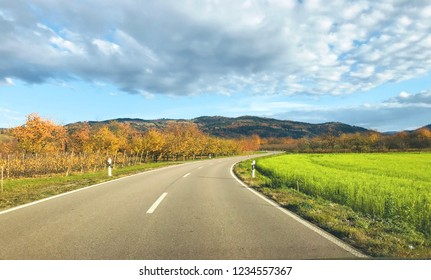 Autumn landscape on the road in Germany,blue and cloud background,nature backgrounds,