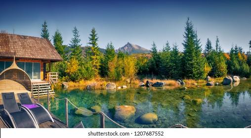 Autumn landscape panorama with spa, mountain peak and a lake, Krivan, High Tatras, Slovakia, Europe