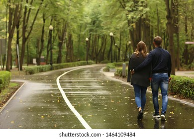 autumn landscape with people in the park / gerfrend and boyfriend hug in autumn park, fall view person