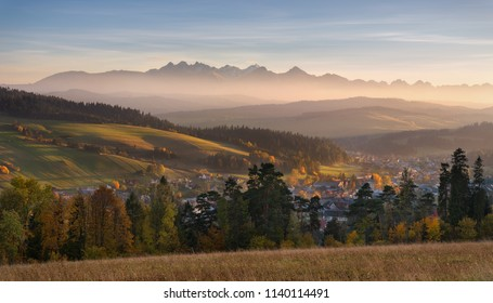 Autumn Landscape Of Poland Tatra Mountains. Beautiful View Of High Tatras And Picturesque Sunny Valley. Polish Rural Landscape With Tatry Mountain At Sunset.