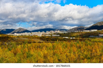 Autumn landscape of the polar city of Kirovsk in the Khibiny mountains from the valley. Kola Peninsula, Murmansk region, Russia.