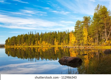 Autumn landscape with a reflection in the lake