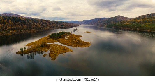 Autumn landscape in Siberia, flight over islands on the Yenisei River, shooting from air. soft focus, panorama