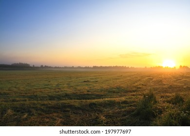 autumn landscape with sunrise and fog