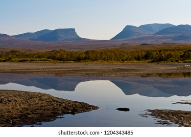 Autumn landscape with Tornetrask lake and u-shaped valley named Lapporten (The Lapponian Gate) in background. Northern Sweden