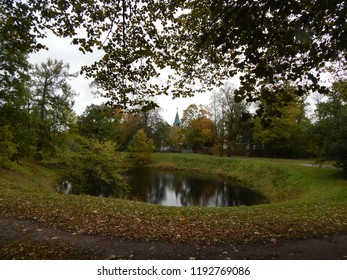 Autumn landscape with trees and a pond