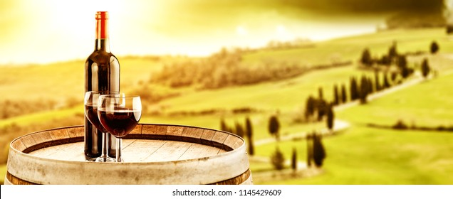 Autumn landscape of Tuscany and barrel background with grapes and wine decoration. Free space for your text.