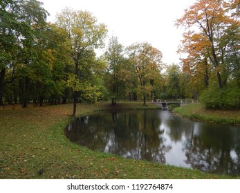 Autumn landscape with water and a bridge