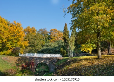 A autumn landscape with white small bridge