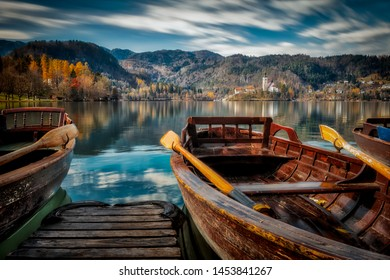 Autumn landscape with wooden boats at the Lake Bled